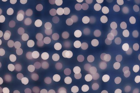 fill in: Celebration in the city. Luminous garlands. Soft, colorful bokeh different colors. Fill the entire background. Tender tones blue, purple, lilac, brown.