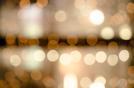 fill in: Celebration in the city. Luminous garlands. Soft, colorful bokeh different colors. Fill the entire background. Tender tones brown, yellow, white, green.