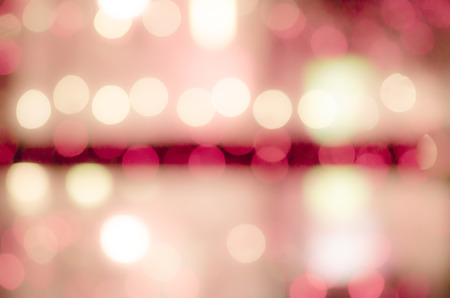 fill in: Celebration in the city. Luminous garlands. Soft, colorful bokeh different colors. Fill the entire background. Tender tones green, yellow, red, crimson.