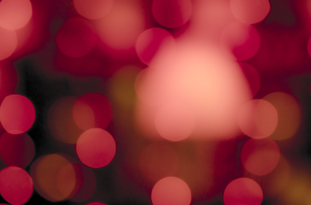 Soft, large, colorful bokeh different colors. Fill the entire background. Tender tones pink, red, orange, crimson. Stock Photo