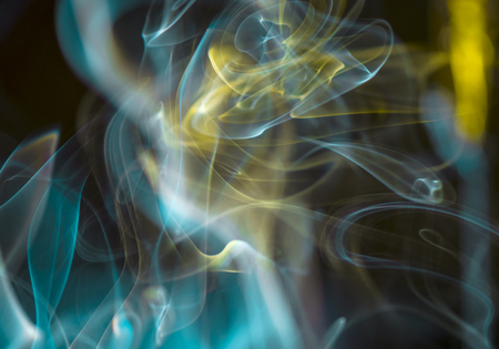 Thick, scenic clouds of smoke. From incense, or cigarettes, or cigars. Indoors. In the rays of sunshine on a dark background. Psychedelic mood. Close up. Colorful abstract background. Stok Fotoğraf - 80895400