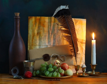 still life with fruit, old letters with a pen and a candle photo