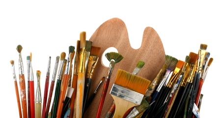 craft supplies: Brushes with a palette isolated on a white background Stock Photo