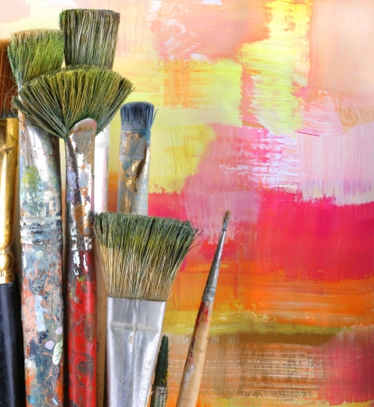 Paintbrush on painted background.