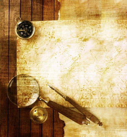 Compass and magnifier on textured paper  Stock Photo