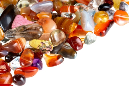 collection of beautiful precious stones against white background photo