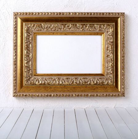 old  frames over the white wall background  Stock Photo