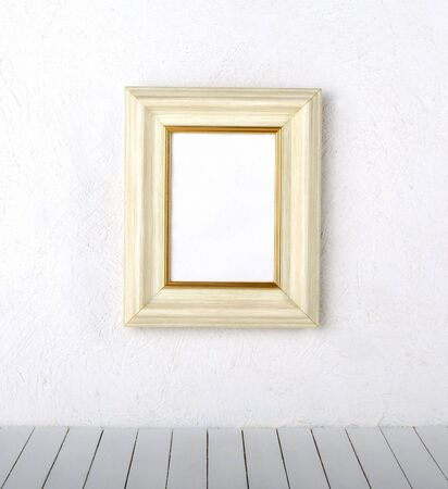 old  frames over the white wall background  Banco de Imagens