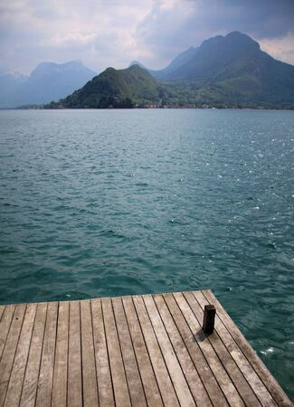 View from a wooden jetty over Lake Annecy photo
