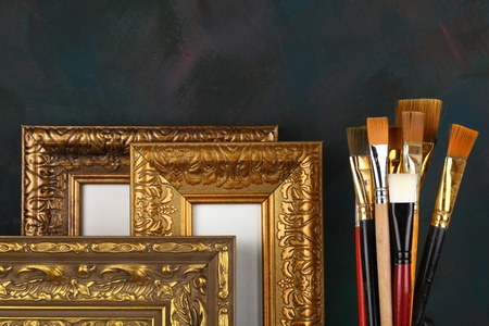 antique frame and paintbrushes
