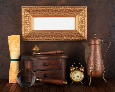 Picture gold frame with ancient subjects. Still-life. Stock Photo