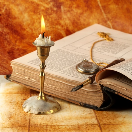 Candle with book Stock Photo