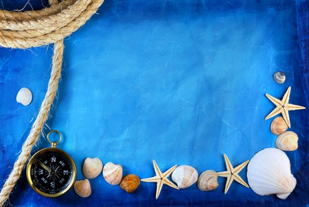 compass and rope on a blue background  photo