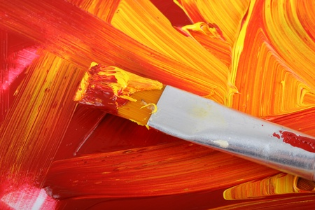 mixing: mixed oil paint with paintbrush Stock Photo