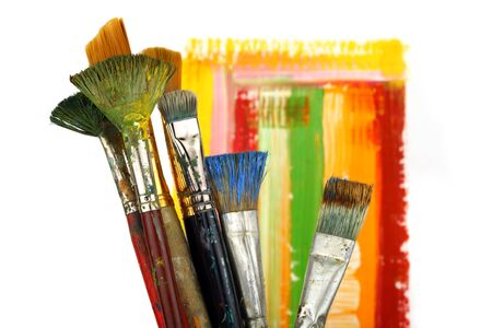 Paintbrush on painted background.  photo