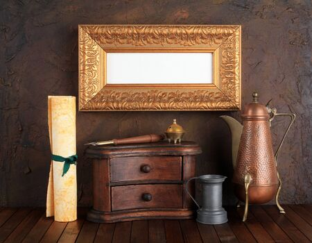 Picture gold frame with ancient subjects  Still-life  photo