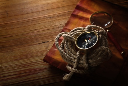 compass and rope on a wooden table  photo