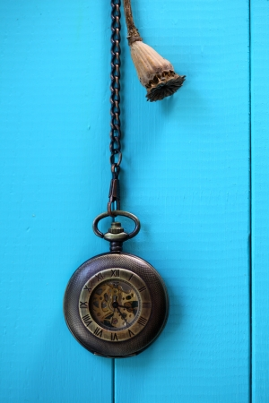 antique pocket watch on blue wooden table Stock Photo