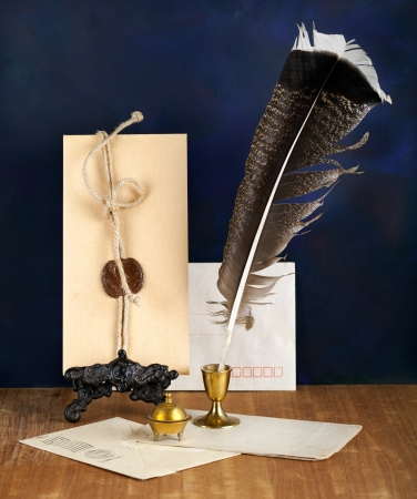 Blank Antique letter with feather pen and a candle photo