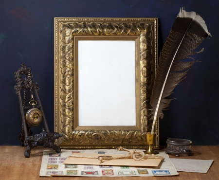 Old letters , vintage frame and a quill pen photo