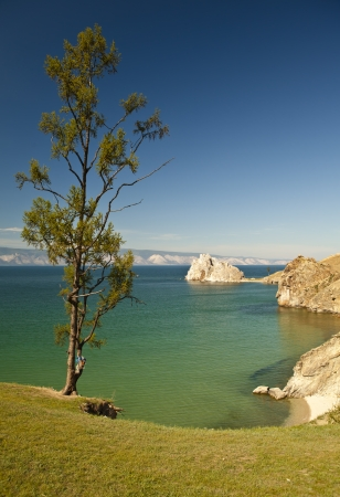 Cape Burhan and Shaman Rock on Olkhon Island at Baikal Lake, Russia photo