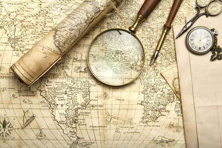 Vintage map with retro objects and magnifier Banque d'images
