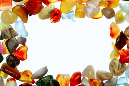 crystal therapy: collection of beautiful precious stones against white background