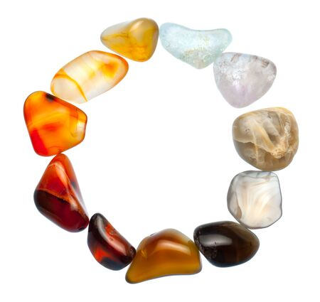 semiprecious: Colorful natural stones arranged in a circle, isolated on white.