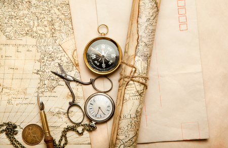 old items: Old map with compass and retro items Stock Photo
