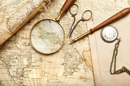 cartographer: Vintage map with retro objects and magnifier Stock Photo
