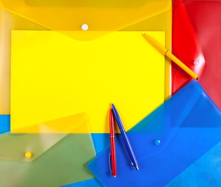 plastic envelopes with colored  pens