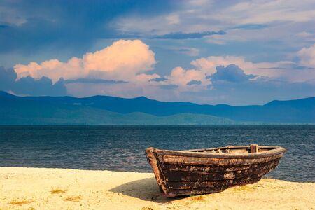 flotation: boat on the sandy shore of Lake Baikal