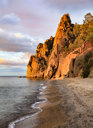 steep cliffs: beach at the steep cliffs on the lake