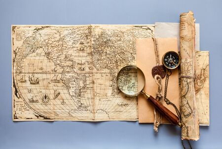 vintage objects: Vintage map with retro objects and magnifier Stock Photo