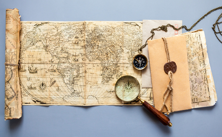 Vintage map with retro objects and magnifier Stock Photo