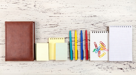 diaries: Office  table with notepads, diaries and pens