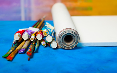 Pure blank canvas and professional  paints in tubes,  with artistic  brushes.
