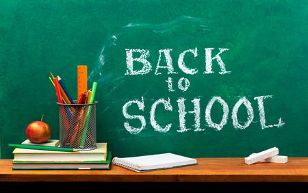 school board: School books on desk, education concept.Text Sign Concept Back to School . Stock Photo