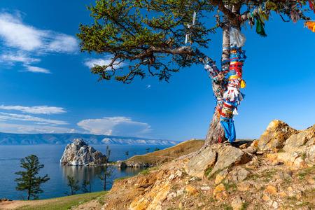 Landscape at the Baikal lake in Siberia Tree of desires on cape Burhan of Olkhon Island on Lake Baikal, Russia