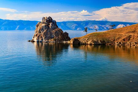 shamanism: Cape Burhan and Shaman Rock on Olkhon Island at Baikal Lake, Russia. Stock Photo