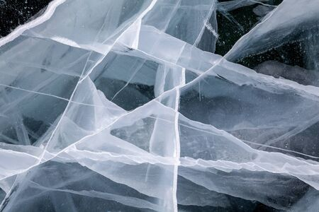 ice texture on a lake water in winter outdoors with snow Stock Photo