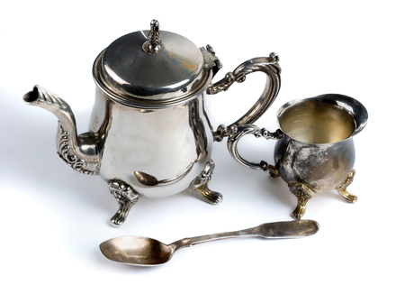 Small teapot and cup. Old silver.