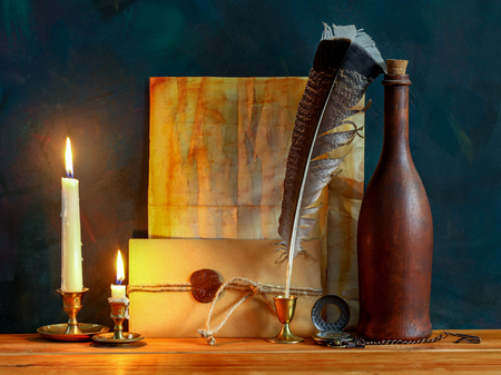 Blank Antique letter with feather pen and a candle
