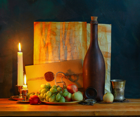 Still life with fruit,  letters , quill pen and a candle