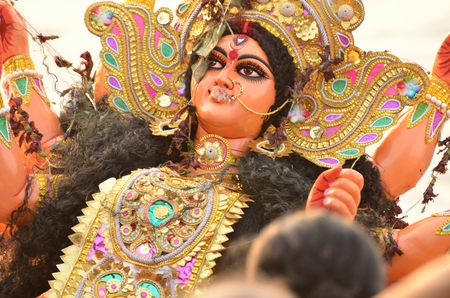 immersion: Immersion of goddess durga idol in river after completion of festival Stock Photo