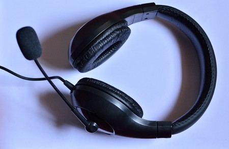 telecommunications equipment: Headphone with mouth piece isolated on blue background