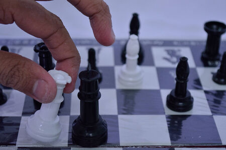 playing the market: Playing chess game strategic move to win market Stock Photo