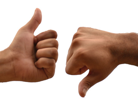 man's thumb: Thumbs up and down isolated on white background