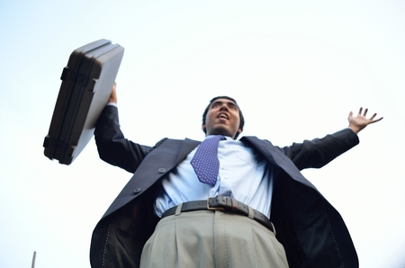stretched: Successful businessman stretched hand with briefcase