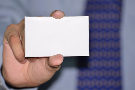 Businessman showing white empty card photo